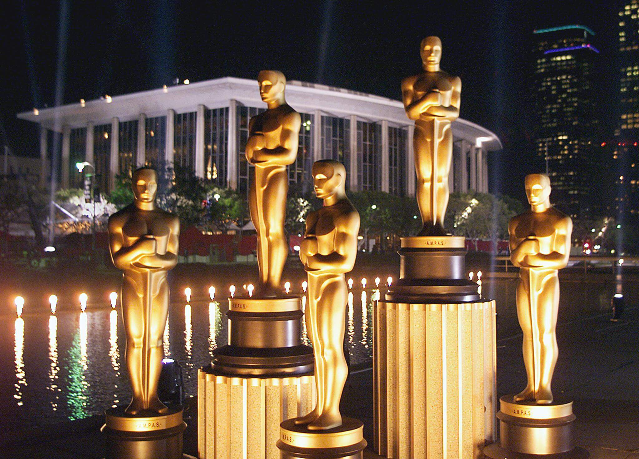 Replicas of Oscar statues are lit in the night out