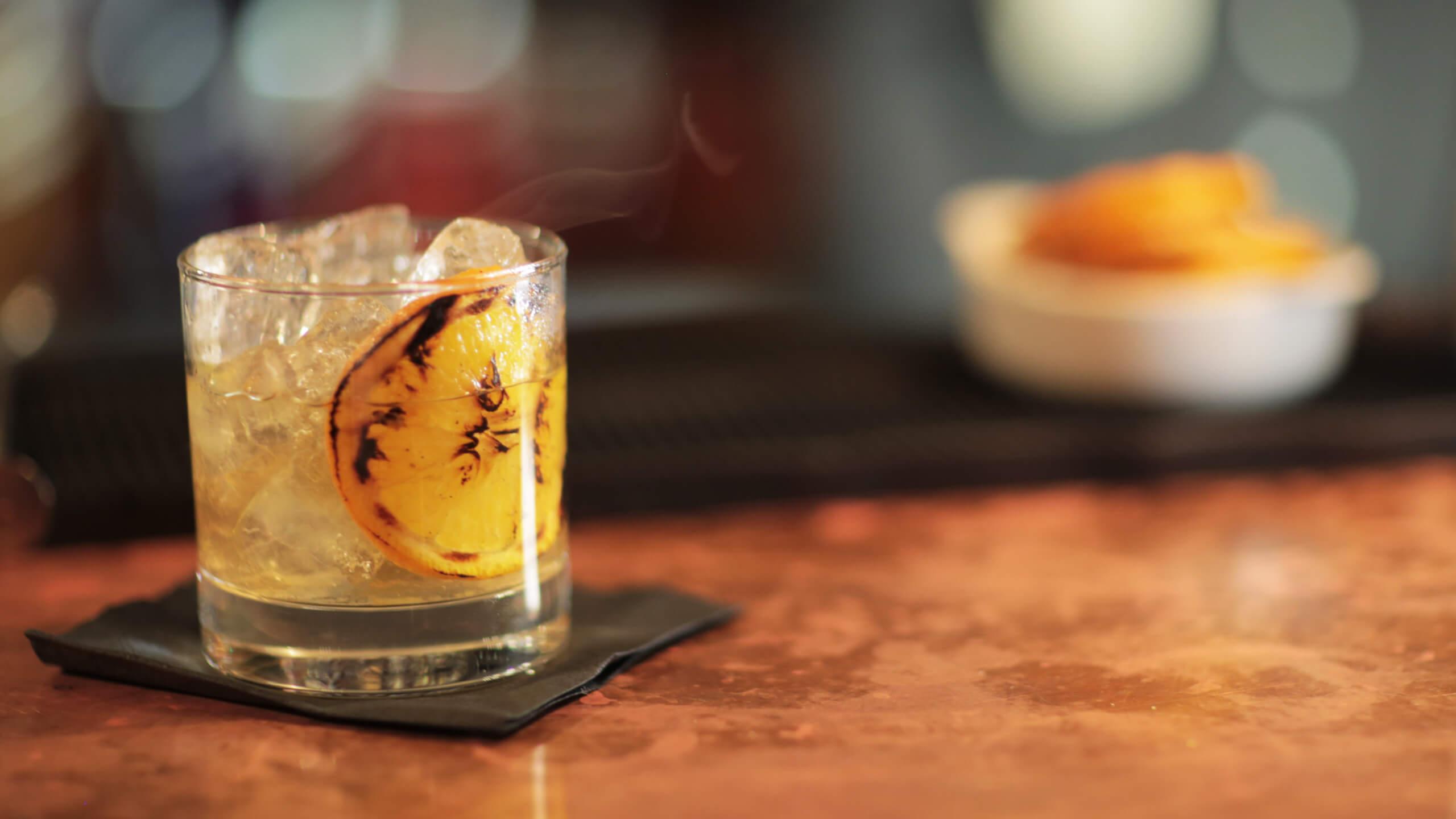 Maricastana (tequila, agave, tamarind, mole bitters and charred orange)