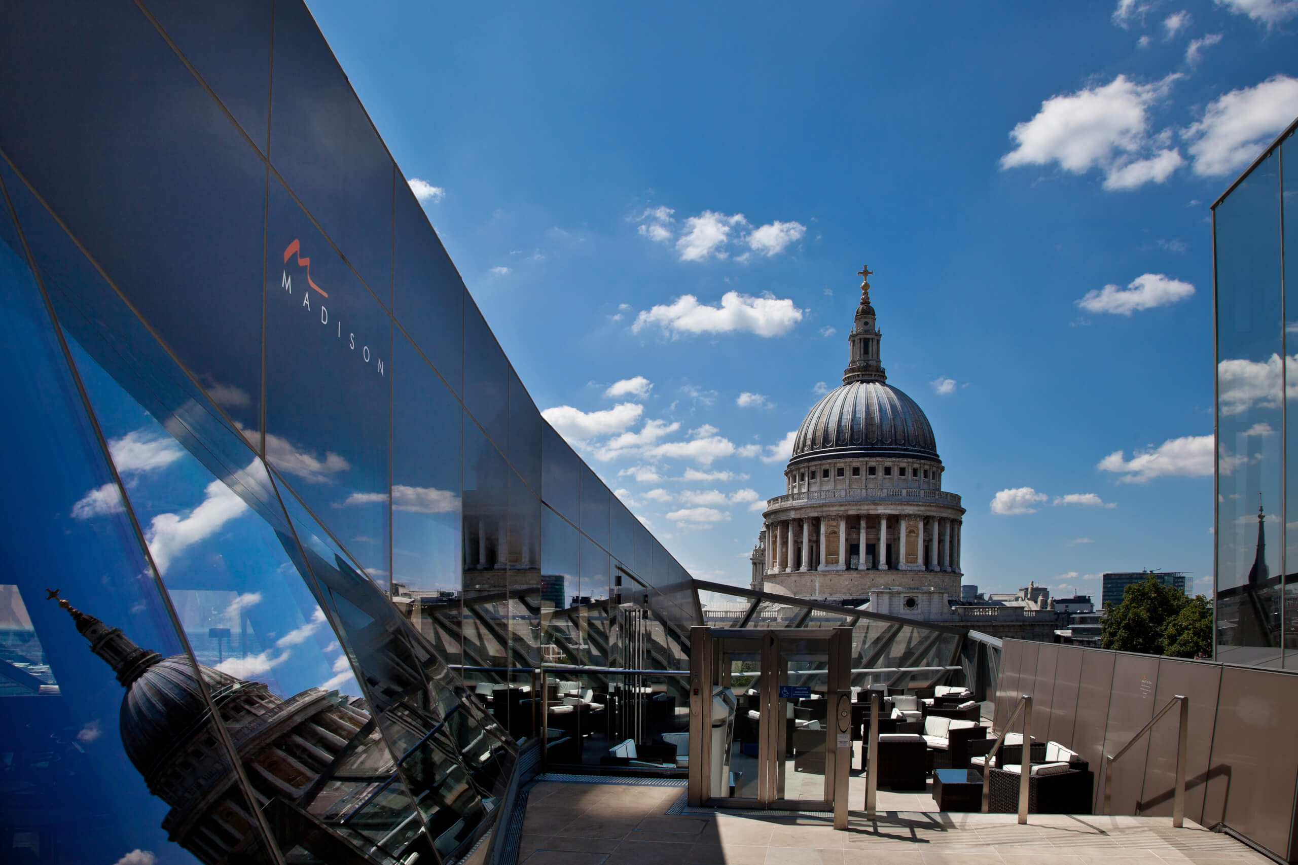 Next to the cluster of intimidating office blocks, where business is  churned out like eggs from battery hens, lies one of London's best  cherished rooftop ...