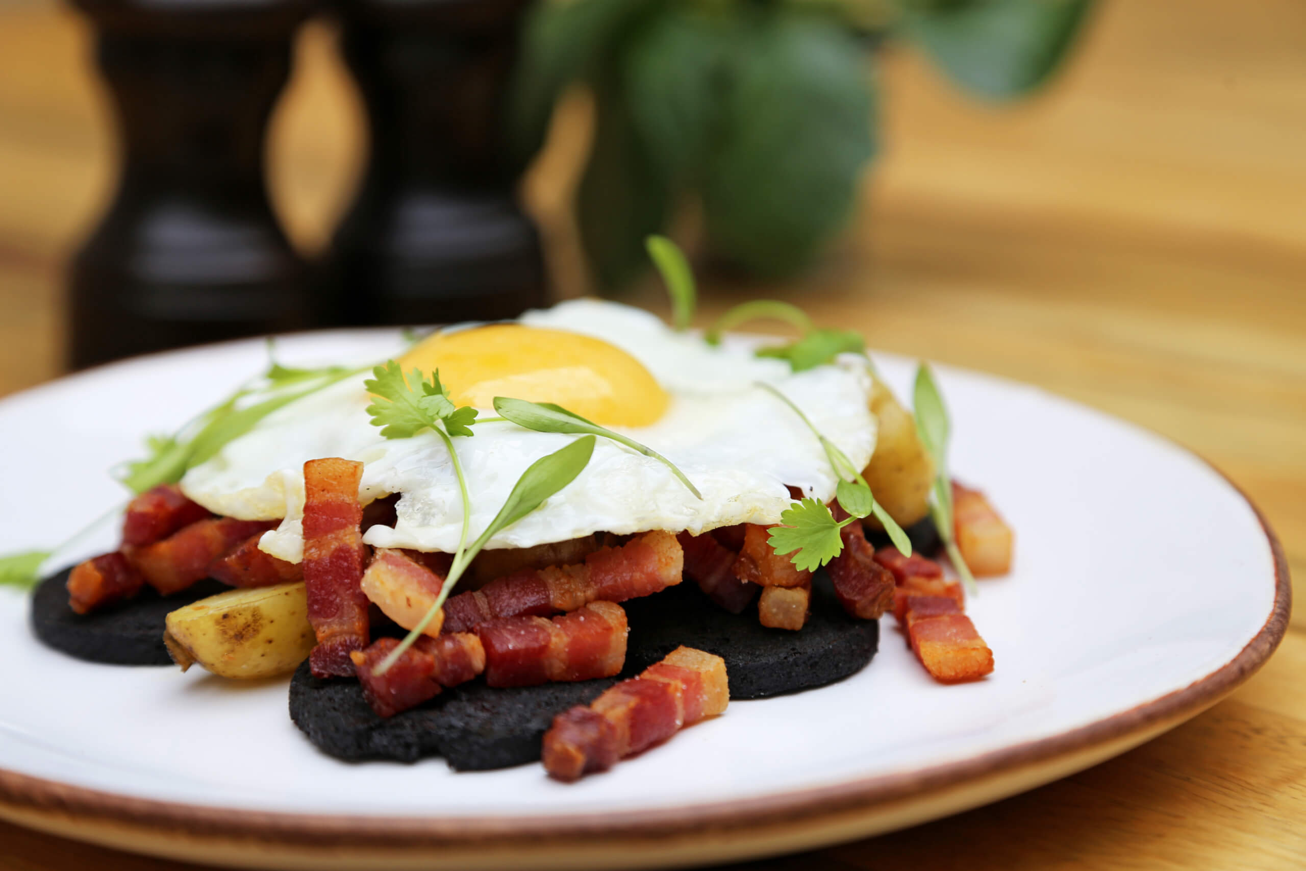Sauteed Jersey Royals with bacon, black pudding and egg sunny side up