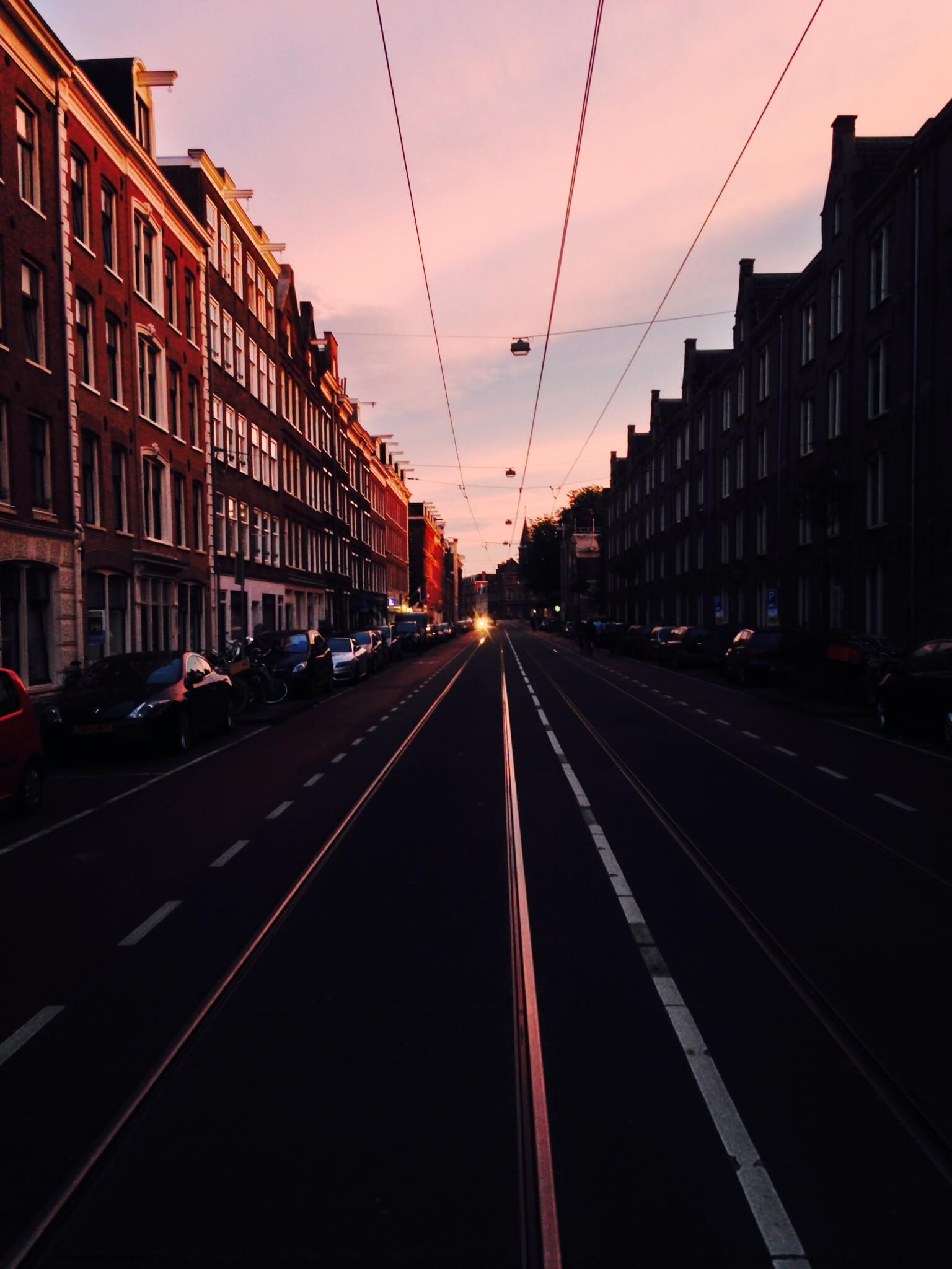 Amsterdam sunset, street, tram road, things to do in amsterdam
