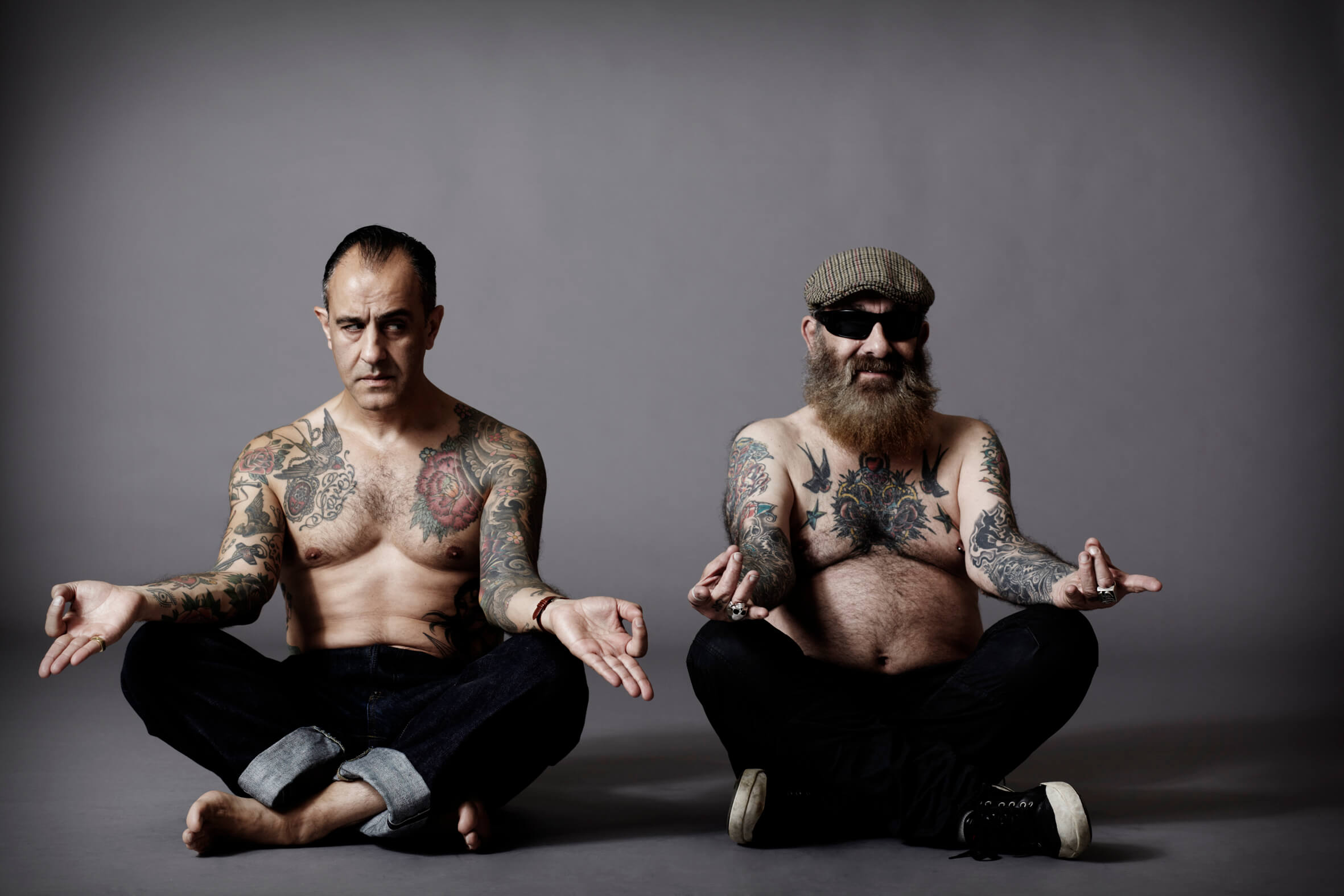 Two-Tattooed-Men-Sitting-Down